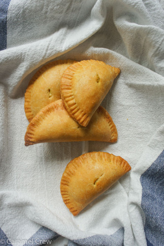 Savory chicken empanadas with a creamy curry & cheddar filling with fresh cilantro. Easy empanada recipe for the ultimate comfort food, snack or appetizer.