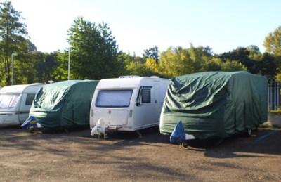 caravans in storage with caravan covers