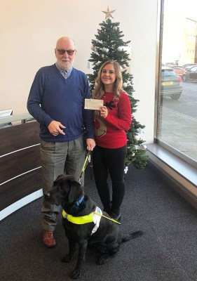 Guide dogs for the blind receive cheque from Caravan Guard for charity-mas