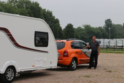 Seek professional assistance when reversing a caravan