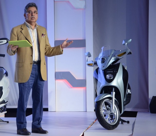 Mr. Pawan Munjal, MD & CEO, Hero MotoCorp with the Hero Leap Hybrid Scooter