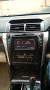 2015-toyota-camry-hybrid-review-centre console