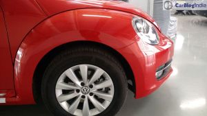 new-volkswagen-beetle-india- orange-side-front