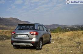 maruti vitara brezza review images rear angle silver 2