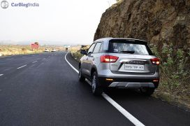 maruti vitara brezza review images rear angle silver