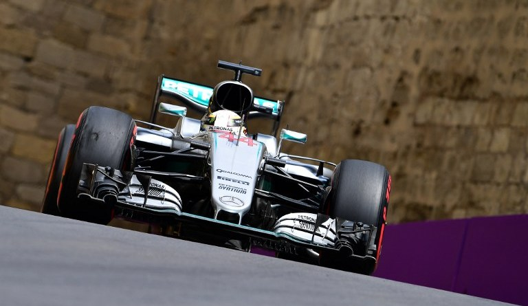 Mercedes AMG Petronas F1 Team's British driver  Lewis Hamilton steers his car at the Baku City Circuit, on June 17, 2016 in Baku, during the first practice session for the European Formula One Grand Prix.  / AFP PHOTO / ANDREJ ISAKOVIC