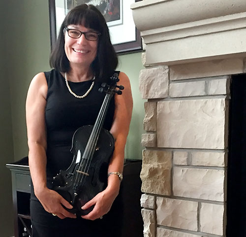 Eva Tysdale holds her new carbon fiber violin, The Gayford Carbon Strad