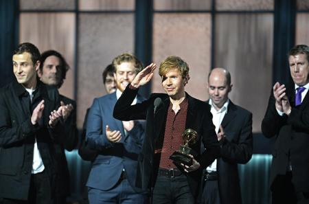 Beck accepts the Grammy award for Album of the Year