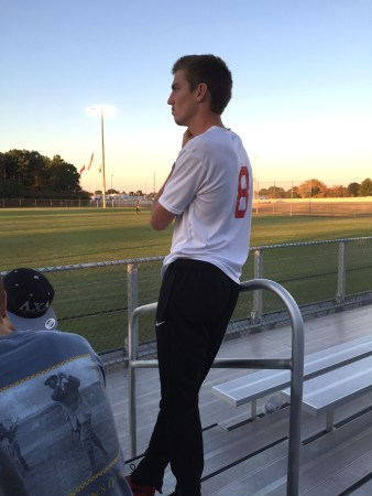 Clayton Martin, senior sports management major, watches from the stands as his team plays Ouachita Baptist