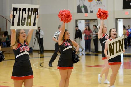 Cheerleaders energize crowd during homecoming game | Photo by Emily Stookey