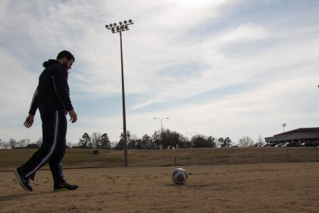 Matthew Kesler, senior philosophy major, places the ball before shooting. |Photo by Chris Boccarossa