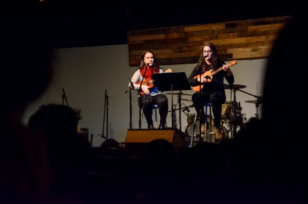Rachel Carver, senior exercise science major, and Olivia Winters, senior english major, perform at Open Mic. | Photo by Gretchen Foels, staff photographer