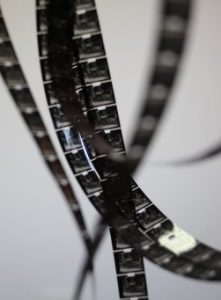 9.5mm film has a sprocket hole in the middle.