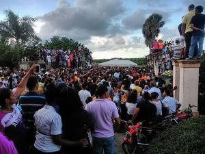 Thousands of people gathered Tuesday in the Dominican Republic to say goodbye to Oscar Taveras, who died on Sunday as a result of a car accident. (Photo by Franklin Martinez)