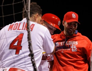 Sep 30, 2016; St. Louis, MO, USA;  St. Louis Cardinals pinch hitter Matt  Holliday (7) is congratulated by catcher Yadier  Molina (4) and starting pitcher Adam  Wainwright (50) as he enters the dugout after hitting a solo home run during the seventh inning against the Pittsburgh Pirates at Busch Stadium. Mandatory Credit: Scott Kane-USA TODAY Sports