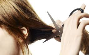 woman cutting her hair