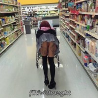 Bending and showing off her pussy in a short skirt inside a shop