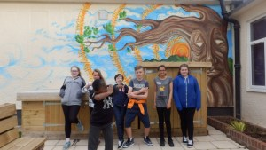 Enjoying the new mural in the Young Carers Zone garden!