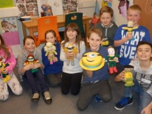 Our latest Heroes group, with delicious birthday cake donated by Free Cakes for Kids Bristol, and fantastic knitted superheroes donated by Bristol district Methodist Churches.