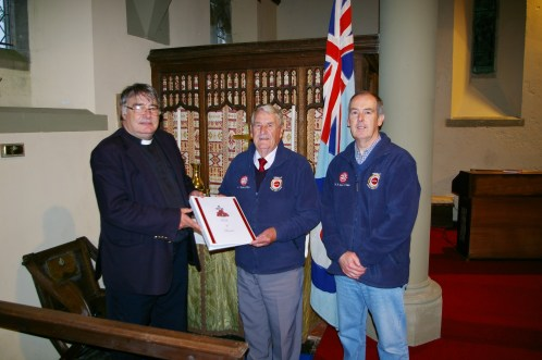 Rev Peter Lewis shows Control Tower Group President, John Brock M.B.E. and Chairman,  Deric Brock, the Robeston Wathen Roll of Honour prepared for the Anniversary of the ending of the Great War on 11th November 2011.