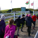 Museum volunteer march Gelli Aur Golden Grove pupils and their teachers around the Carew Cheriton site.