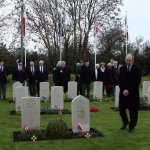 Members of the Cresselly & District branch of the Royal British Legion pay their respects at the Carew Cheriton war graves.