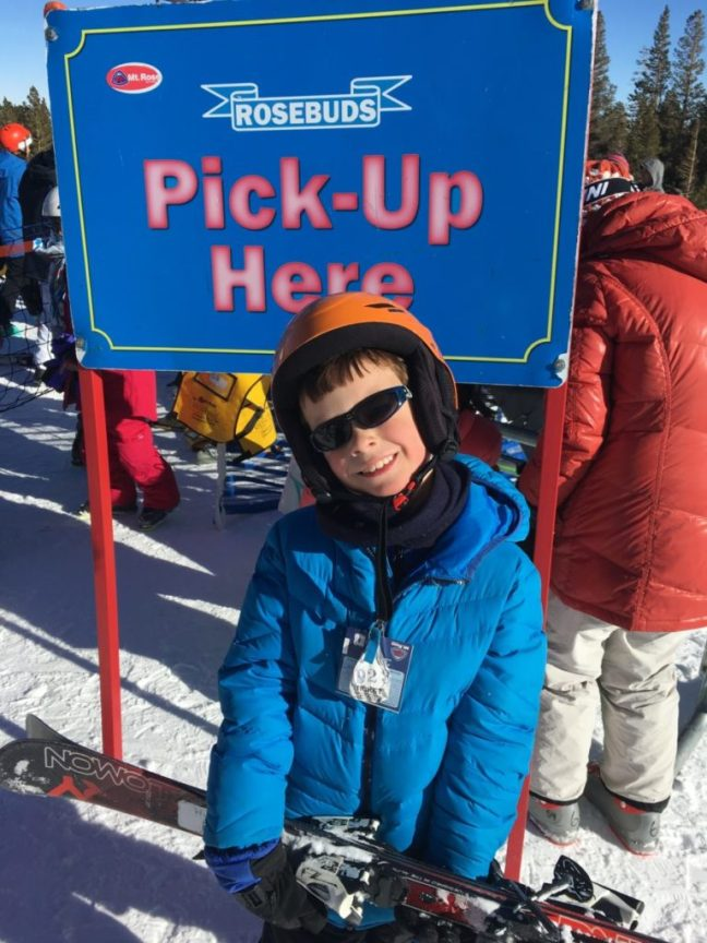 This is a happy kid after his two-hour lesson at Mt. Rose Ski Tahoe, carful of kids, family friendly ski destination