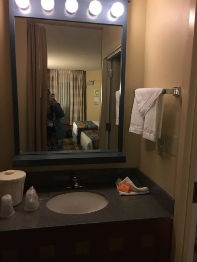 The bathroom vanity at the Pop Century Resort is small. Review of the Pop Century Resort