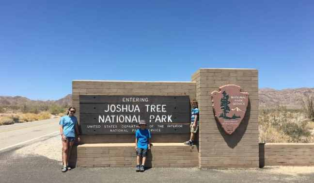 Take a picture with Joshua Tree National Park sign with kids.
