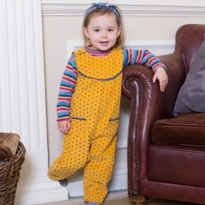 Mustard coloured dungarees with a navy polka dot so some navy detail on the chest and pockets