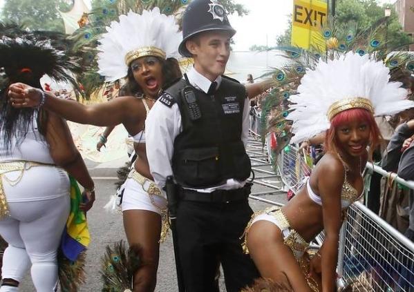 London police enjoying Nottinghill carnival. Photo courtesy www.londonthisweekend.co.uk