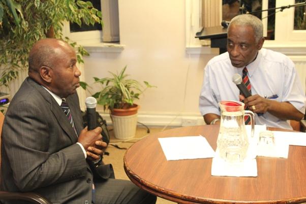 John and Gilmore Smith in discussion. Photo courtesy CaribDirect