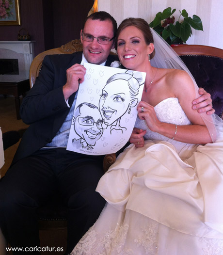 Bride and groom laughing after receiving their live caricature from Allan Cavanagh