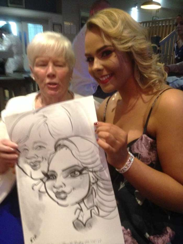 Grandmother and granddaughter with wedding caricature by Allan Cavanagh