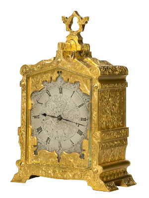 Carriage clock brass with carrying handle sometimes taken when traveling