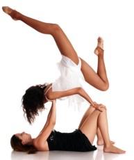 Two girls ballet dancers making stance