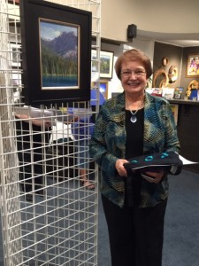 "Contact Carla J Griffin : Carla's Blog : About Carla J Griffin : Press : Image of artist Carla J Griffin with her painting ""Emerald Lake"", winner of a Pastel Society of Oregon award in 2015"