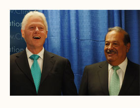 Carlos Slim laughs with Bill Clinton