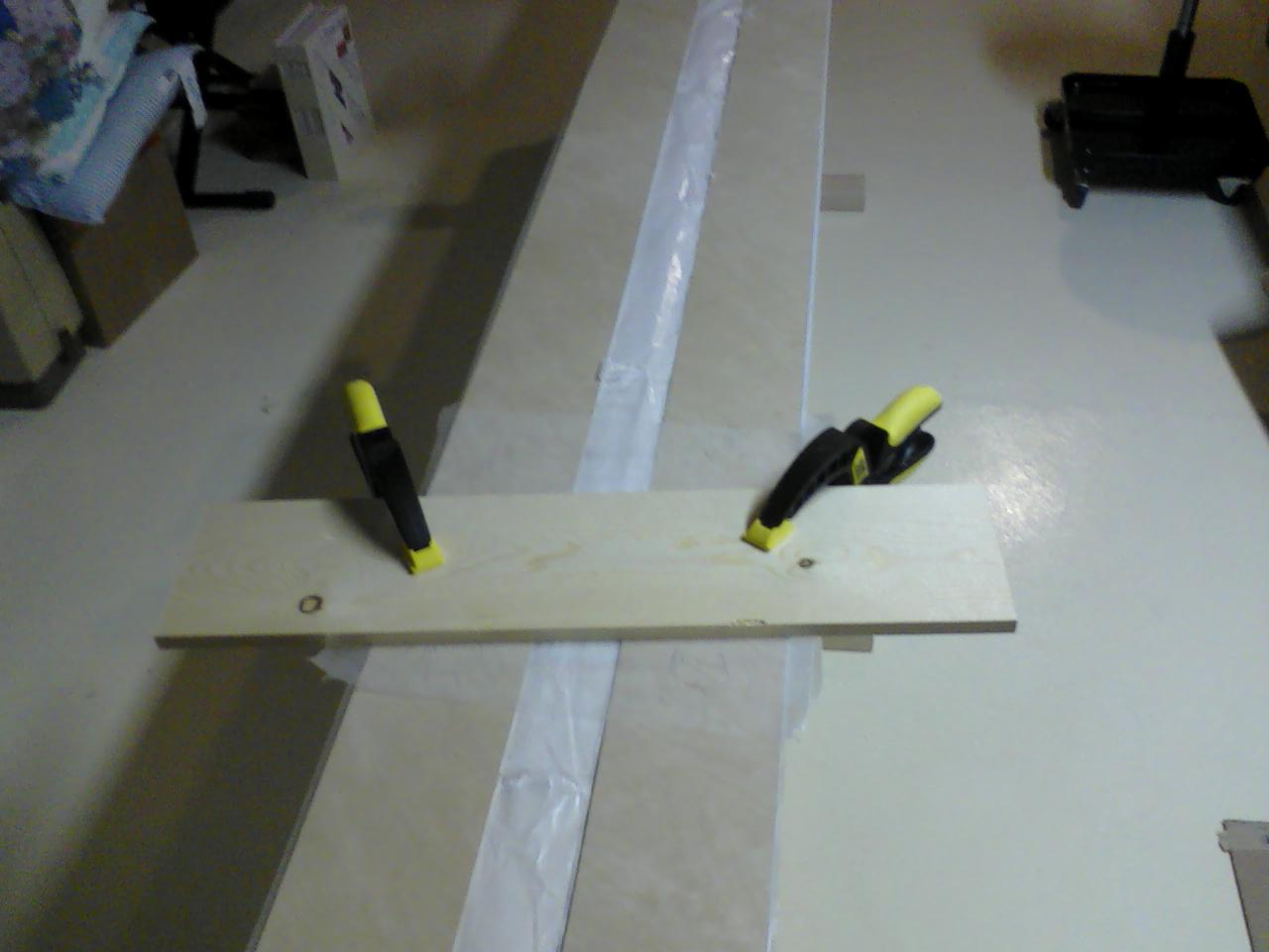 Clamping scarfed plywood