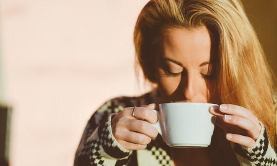 a woman driking coffee