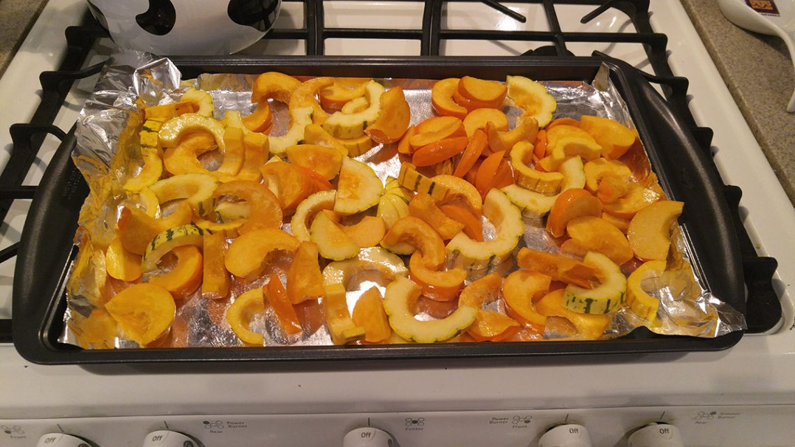 sliced winter squash ready to bake