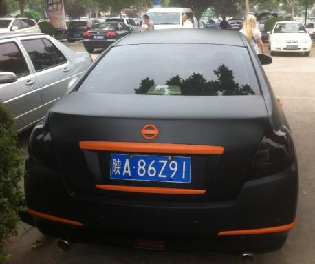 Nissan Teana in matte-black & some orange in China