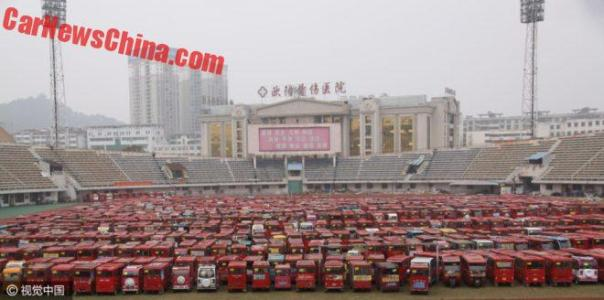 Chinese City Bans Electric Tricycle Taxi's, Dumps Them Into Stadium