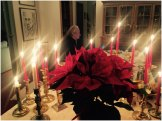 Michel working by Christmas candlelight
