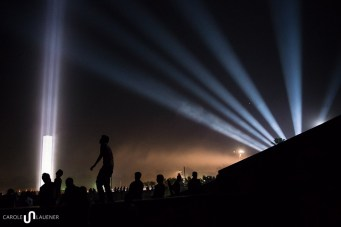 People are enjoying concerts in front of the illuminated Swadhinata Stambha (Independence Monument)