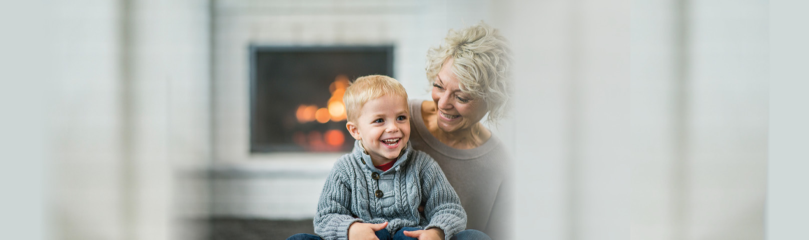 A mature woman and her grandson smile together with clarity in hearing and thinking