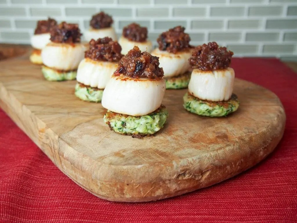 Scallops with cranberry bacon jam make for a stunning and delicious appetizer. Perfect for holiday entertaining or any excuse.