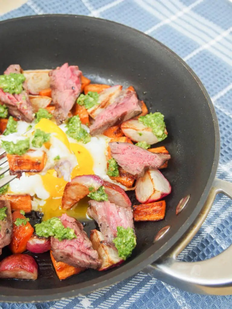 Treat someone to this steak & egg breakfast skillet with sauteed radishes, carrots and radish green pesto - it's a delicious balance of flavors, & easy too.