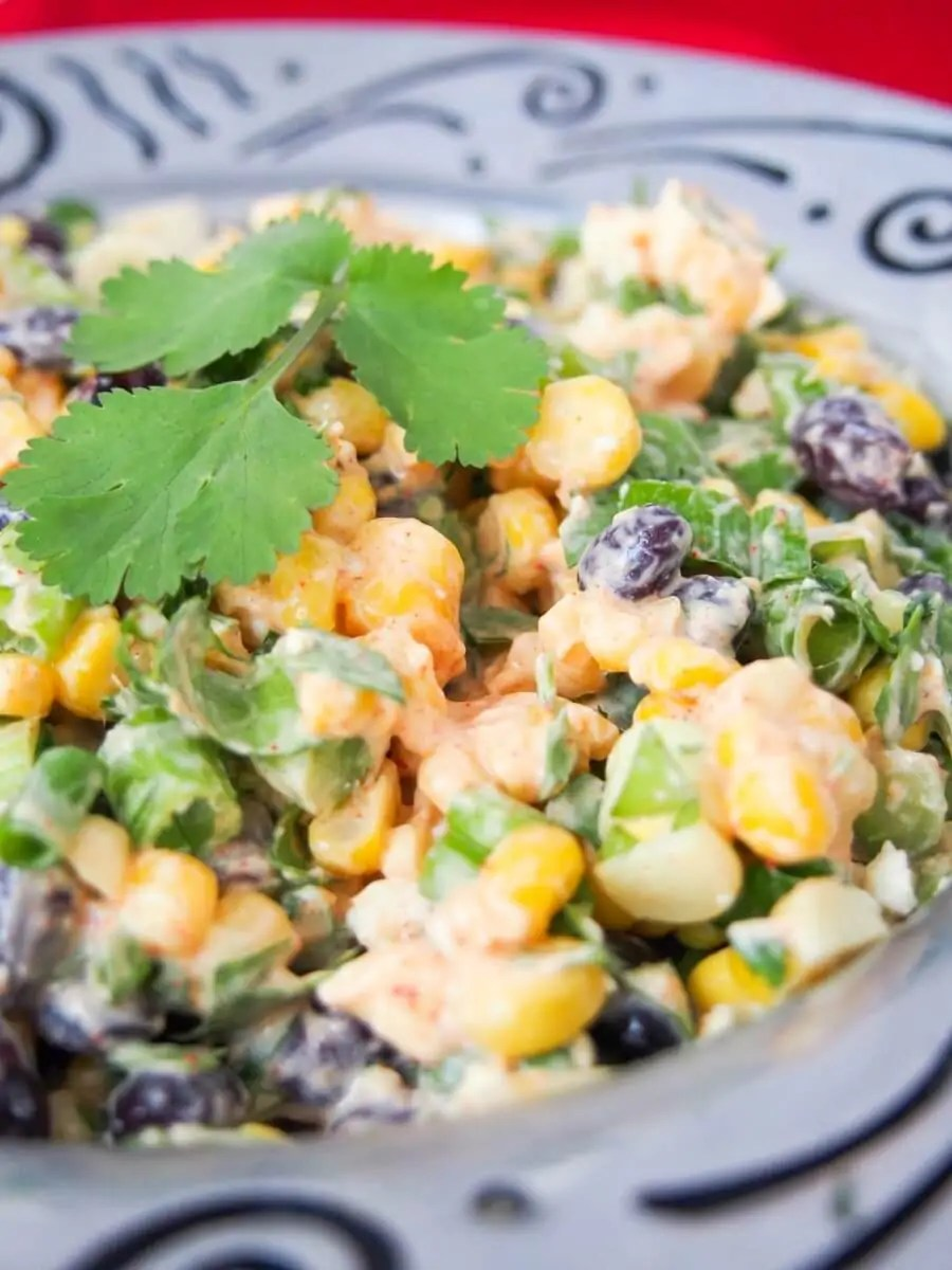 This Mexican street corn salad is easy to prepare and packed with delicious fresh flavors. With a healthier dressing, it makes a great side or potluck salad