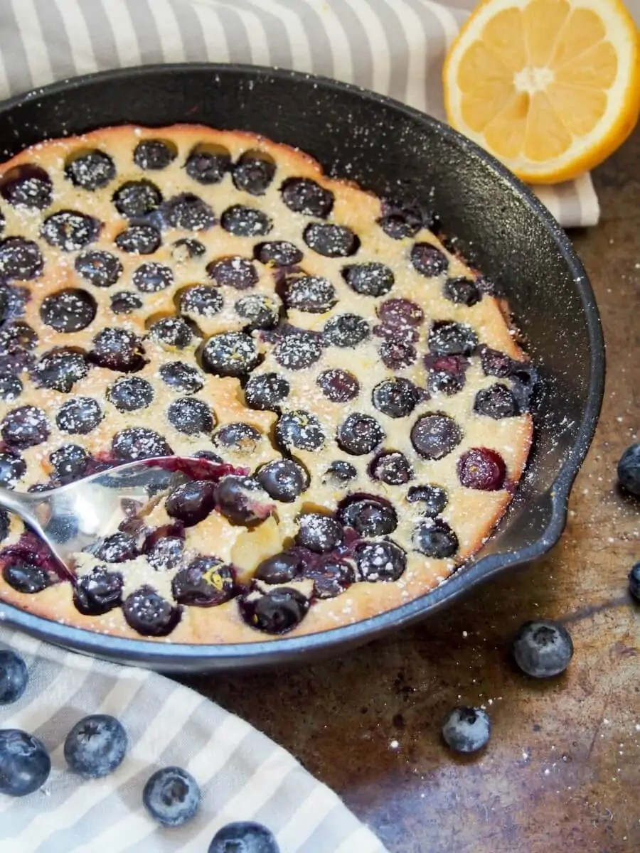 Blueberry clafoutis is a super easy, delicious French dessert, somewhere between a custard and a pancake. Recipe with gluten free version.